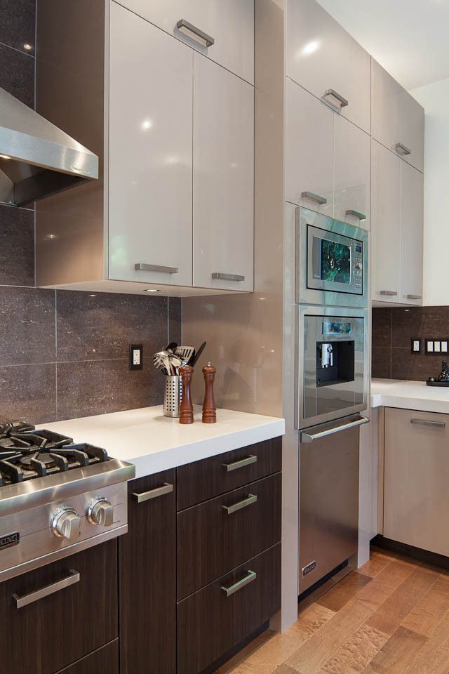Thermofoil for a Contemporary Kitchen with a Stainless Steel and Benz's Project in West Vancouver by Katerina Vallianatos