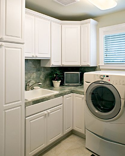 Thermofoil for a Mediterranean Laundry Room with a Cornerstone and Canyon Creek Cornerstone   Glacier Bay Doors Styles in White Thermofoil by Canyon Creek Cabinet Company