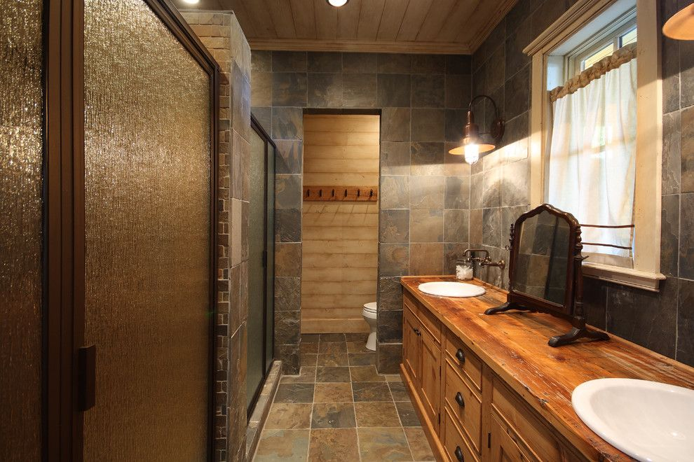 Timberlake Cabinets for a Rustic Bathroom with a Round Sinks and Lake Chatuge Fishing Lodge by Timberlake Custom Homes, Llc