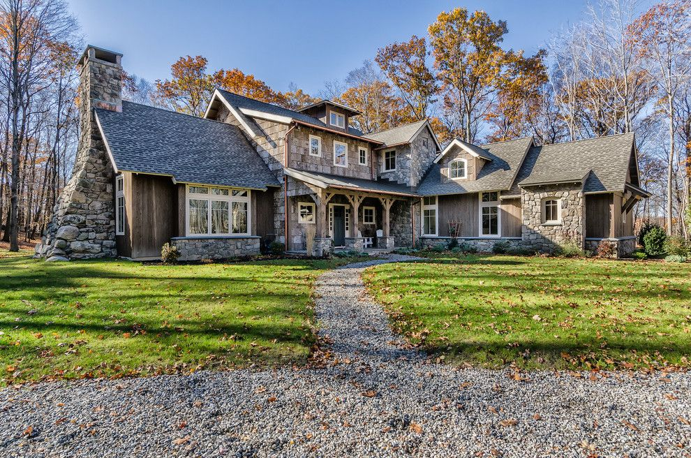 Timberland Homes for a Rustic Exterior with a Log Cabin Lighting and the Beauthaway in Connecticut by Mosscreek
