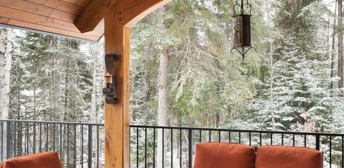 Timberpeg for a Rustic Deck with a Riverbend and Mountain Timber Frame Home in Canada by Riverbend Timber Framing