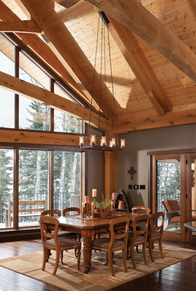 Timberpeg for a Rustic Dining Room with a Dining Room with a View and Mountain Timber Frame Home in Canada by Riverbend Timber Framing