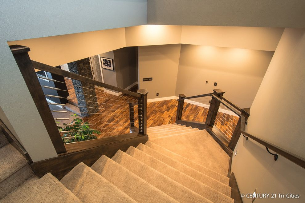 Titan Homes for a Contemporary Staircase with a Cable Railing and Legacy   2014 Parade by Titan Homes Llc