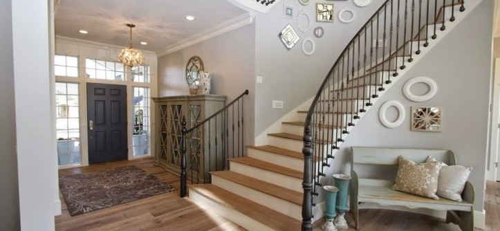 Titan Homes for a Farmhouse Staircase with a Picture Wall and Utah Valley Parade of Homes Spiral Staircase by Titan Homes