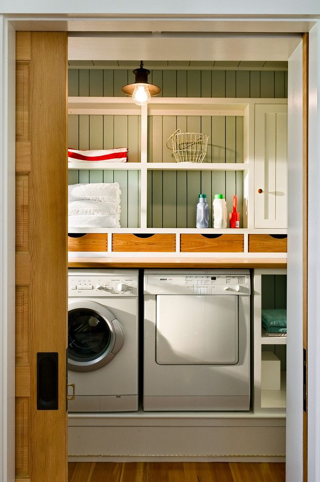 Top Load vs Front Load Washing Machine for a Beach Style Laundry Room with a Pendant Lighting and Laundry Room by Whitten Architects