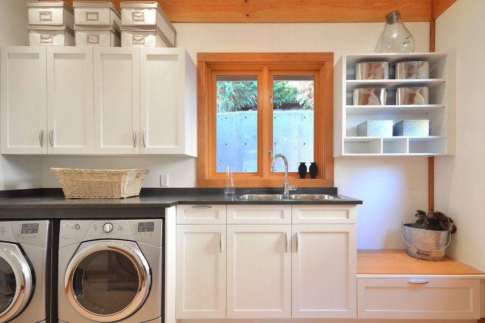 Top Load vs Front Load Washing Machine for a Traditional Laundry Room with a White Drawer and Davis Bay by Streamline Design Ltd.   Kevin Simoes
