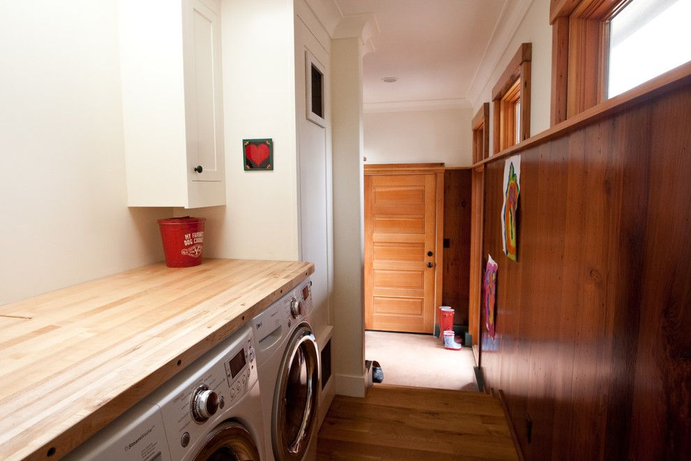 Top Load vs Front Load Washing Machine for a Traditional Laundry Room with a Wood Door and Pw Portfolio by Pecota White Building & Design