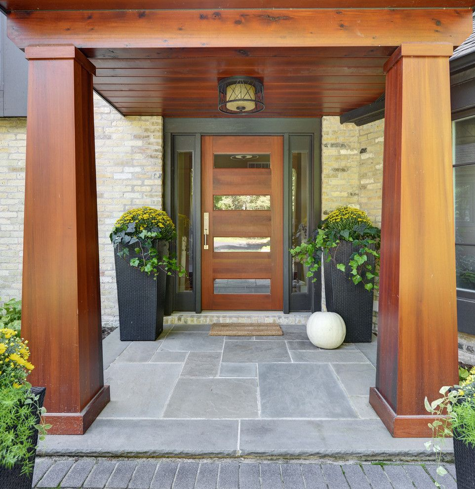 Top Loader vs Front Loader for a Contemporary Entry with a Wood Column and Milwaukee Bluff House by Karen Kempf Interiors