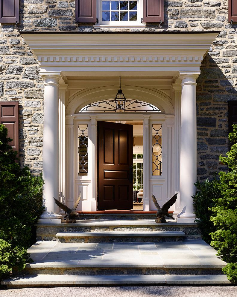 Top Loader vs Front Loader for a Traditional Entry with a Arch Window and Bryn Mawr Stone Colonial by Pinemar, Inc