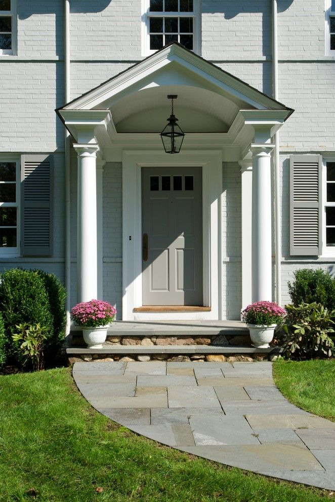 Top Loader vs Front Loader for a Traditional Entry with a Hanging Outdoor Lantern and Huestis Tucker Architects, Llc by Huestis Tucker Architects, Llc