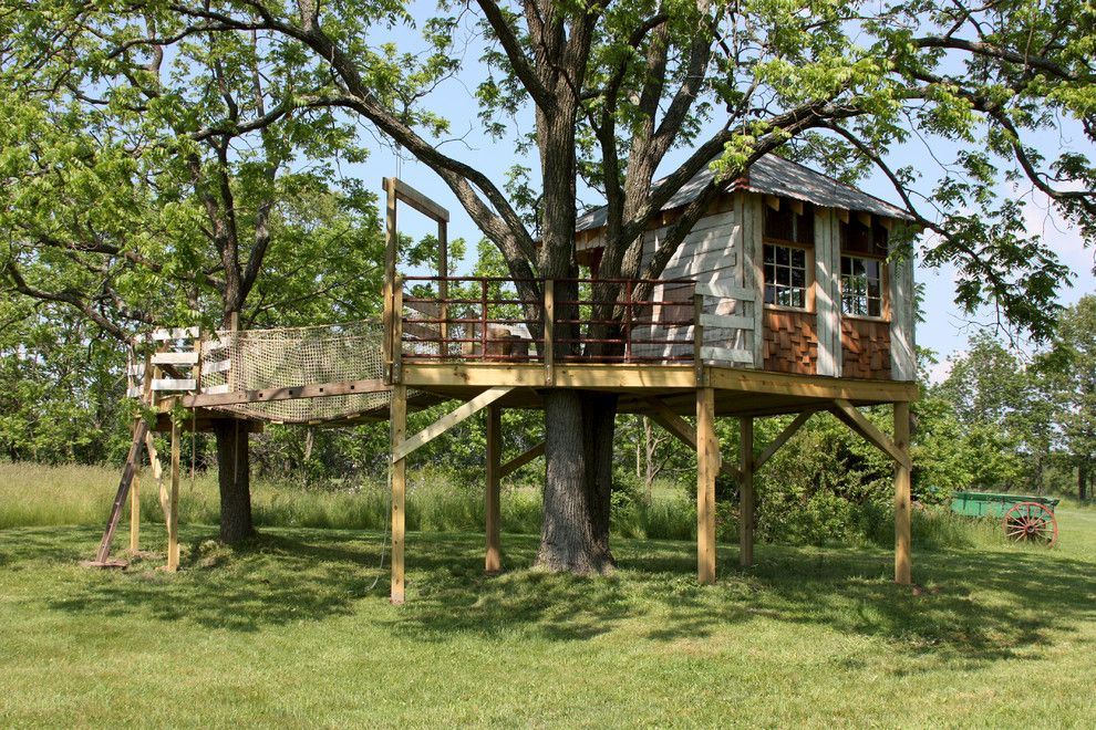 Treehouse Designs for a Eclectic Kids with a Rope Bridge and Unique Projects by Lewis Brothers