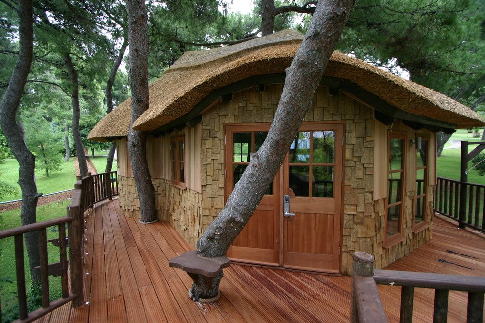 Treehouse Designs for a Rustic Shed with a Thatched Roof and Blue Forest Tree House by Blue Forest Uk Ltd