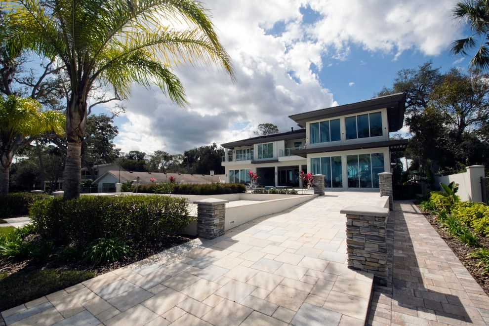 Tremron Pavers for a Contemporary Exterior with a Storefront Glass and Contemporary Riverfront Home by Forever Homes