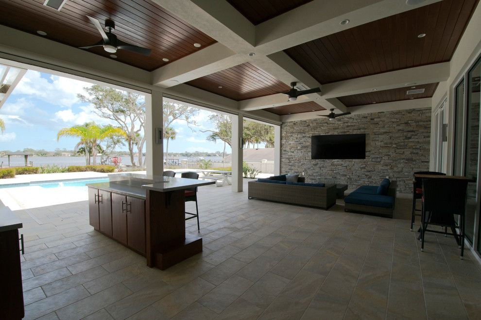 Tremron Pavers for a Contemporary Spaces with a Cypress Tg Ceiling and Contemporary Riverfront Home by Forever Homes