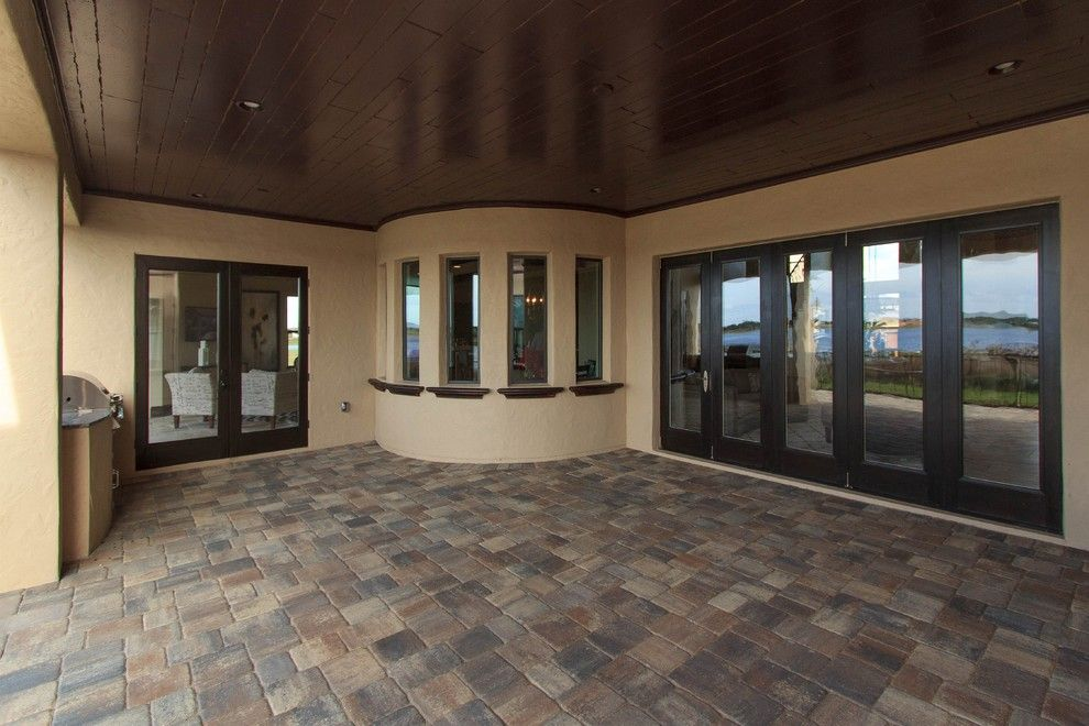 Tremron Pavers for a Mediterranean Exterior with a Mediterranean and La Playa by Cam Bradford Builder