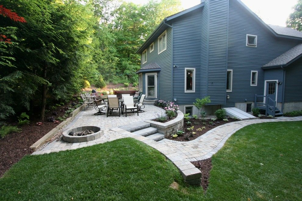 Tremron Pavers for a Modern Landscape with a Stone Walls and Country Home Entrance and Patio by Perennial Landscaping