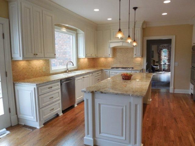 Triton Granite for a Traditional Kitchen with a Travertine Backsplash and Ferrari Kitchen by Triton Stone Group of Nashville