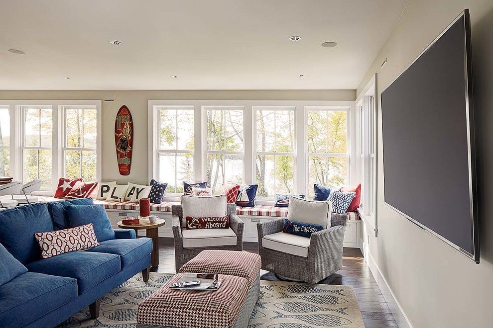 Triton Homes for a Beach Style Family Room with a Blue Accent Pillow and Family Rooms by Magnolia Design Center