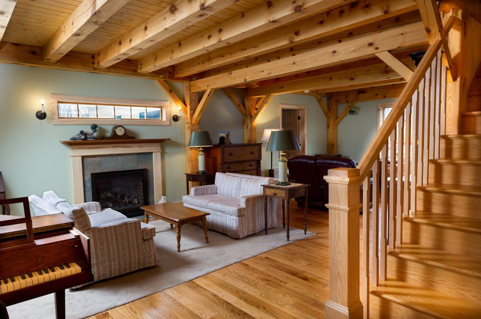 Turkel Design for a Rustic Living Room with a Exposed Beams and Timber Frame Custom Home Scotia,, New York by Bellamy Construction