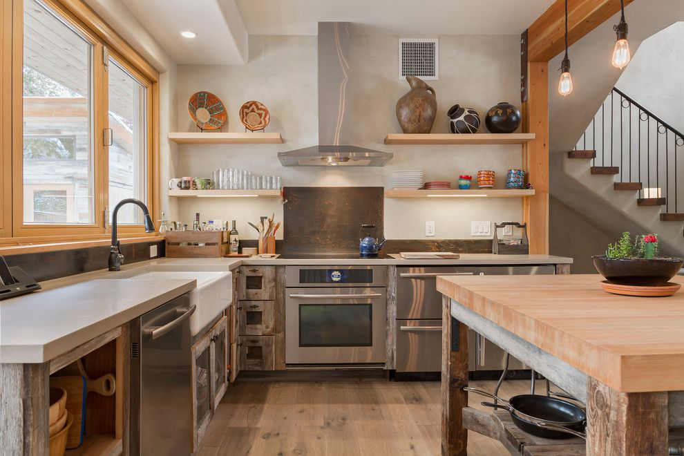 U Save Rockery for a Contemporary Kitchen with a Wood Kitchen Island and Boulder, CO Homes by Dane Cronin Photography