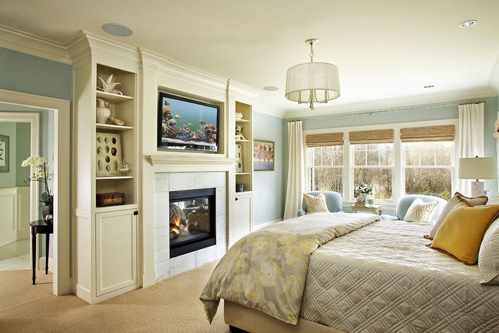 Ubuildit for a Traditional Bedroom with a Tv and Traditional Bedroom by Garrisonhullinger.com