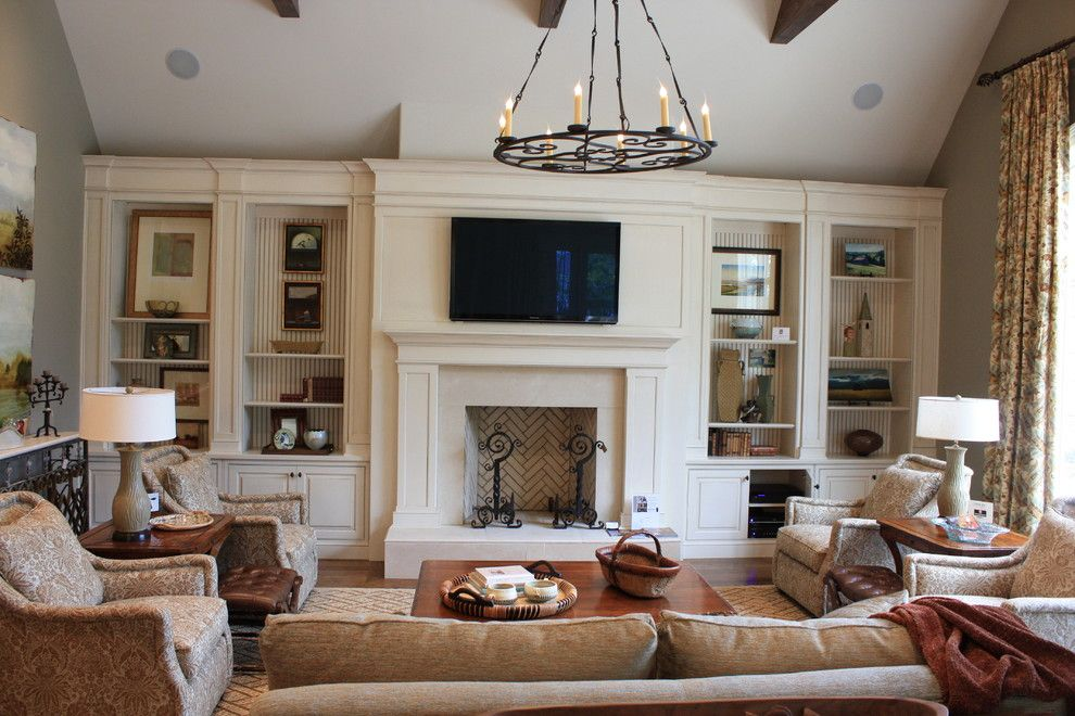 Ubuildit for a Traditional Living Room with a Brick and Family Room Built Ins by Wildwood Cabinetry