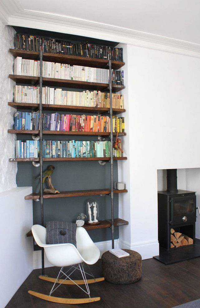 Unclaimed Freight Furniture for a Contemporary Living Room with a Bespoke Steel Pipe Shelving and Sebastian Reclaimed Scaffolding Boards and Steel Pipe Industrial Chic Shelving by Urban Grain