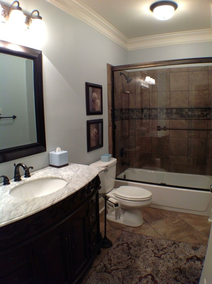Unfinished basement ideas for a traditional basement with for Finished bathroom ideas