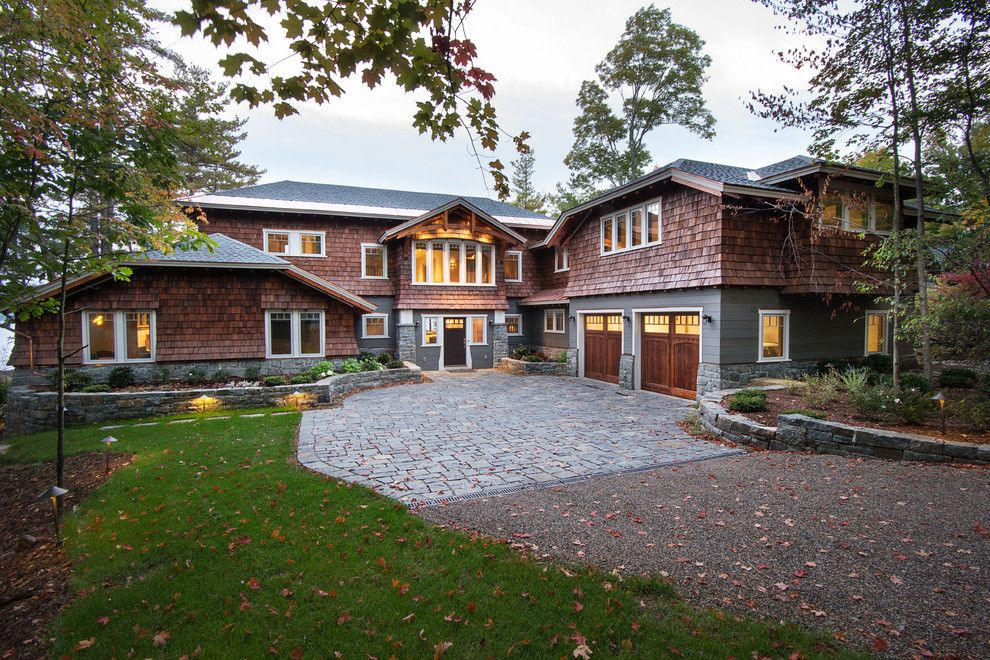 Unilock Pavers for a Rustic Exterior with a Front Door and Great Camp by Phinney Design Group