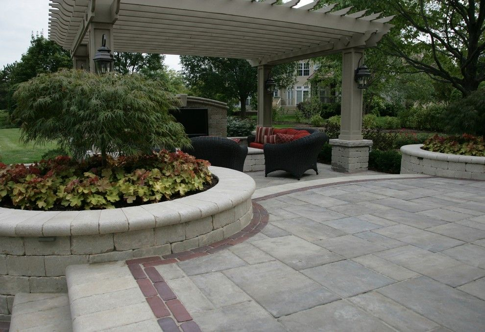 Unilock Pavers for a Traditional Patio with a Brick Paver Patio and Unilock Brick Pavers by Jr's Creative Landscaping