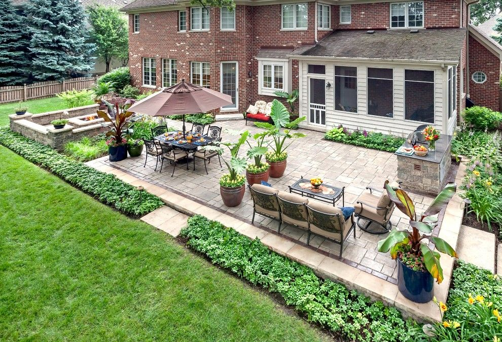 Unilock Pavers for a Traditional Patio with a Screened Porch and Lemont Landscaping by K&d Landscape Management