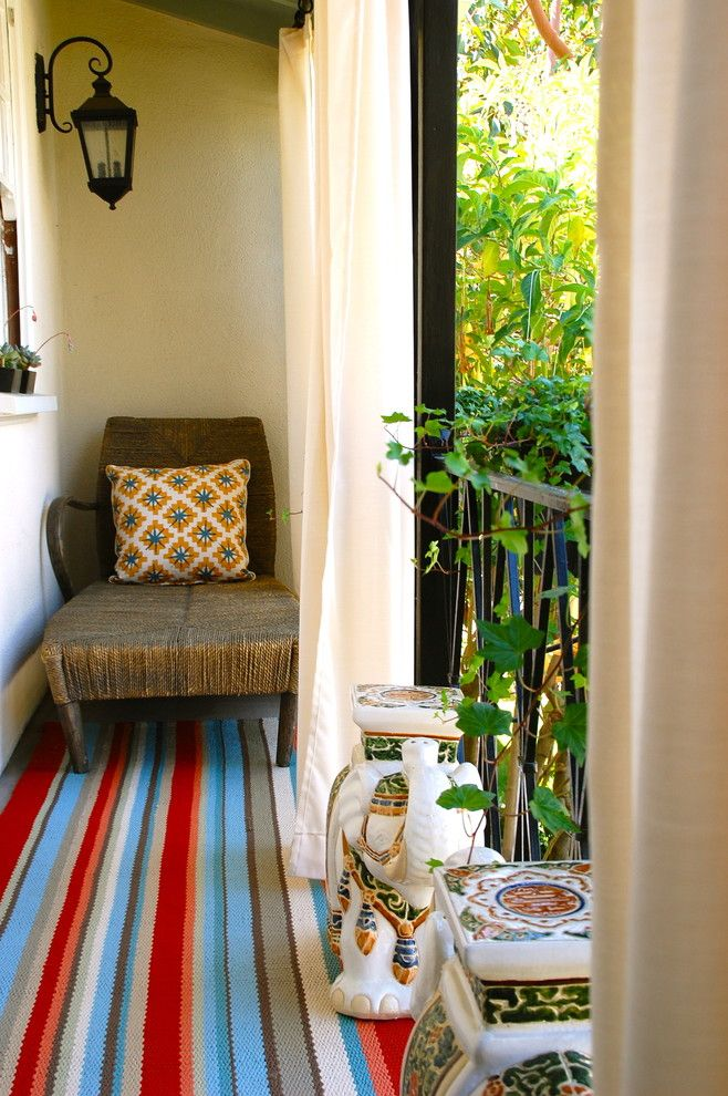 Urban Outfitters Rugs for a Eclectic Porch with a Area Rug and Outdoor Reading Balcony by Lisa Borgnes Giramonti