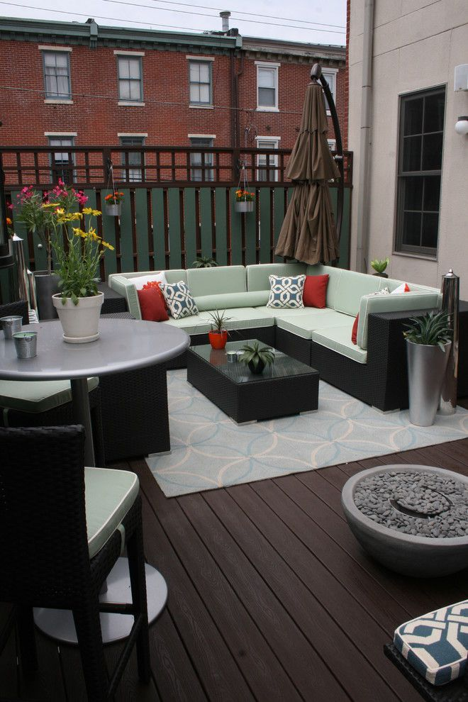 Urban Outfitters Rugs for a Transitional Deck with a Throw Pillows and an Indoor & Outdoor Oasis by Busybee Design