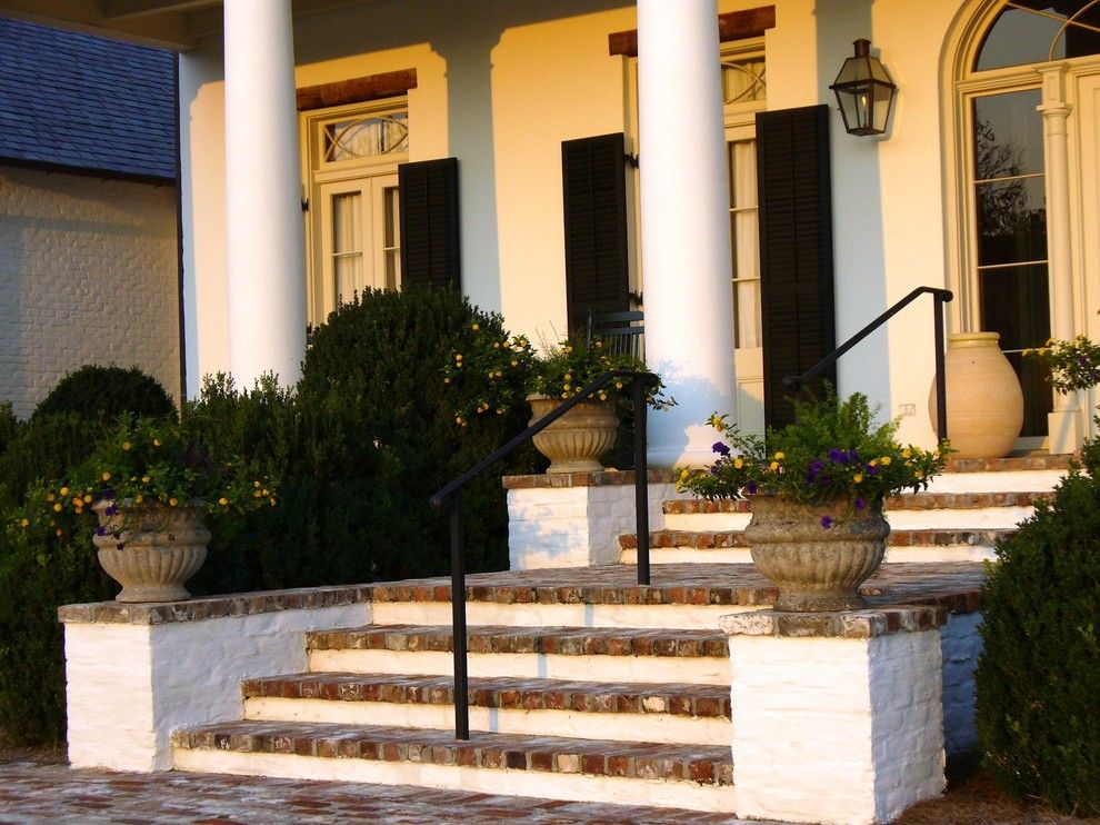 Valley Forge Flowers for a Contemporary Entry with a White Columns and Bevolo Gas and Electric Lights by Bevolo Gas and Electric Lights