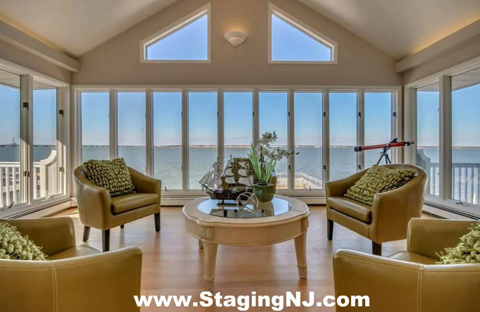 Value City Furniture Nj for a Beach Style Sunroom with a Monmouth County Nj Home Stagers and Luxury Home Staging in Ocean City, Nj  08226 Cape May County, Nj by Beautiful Interiors Design Group