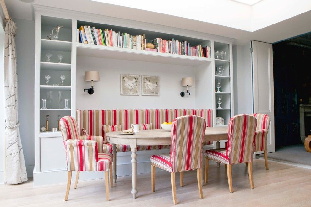 Vaughan Lighting for a Scandinavian Dining Room with a Striped Chairs and Family Home, London by Fiona Andrews Interiors Limited