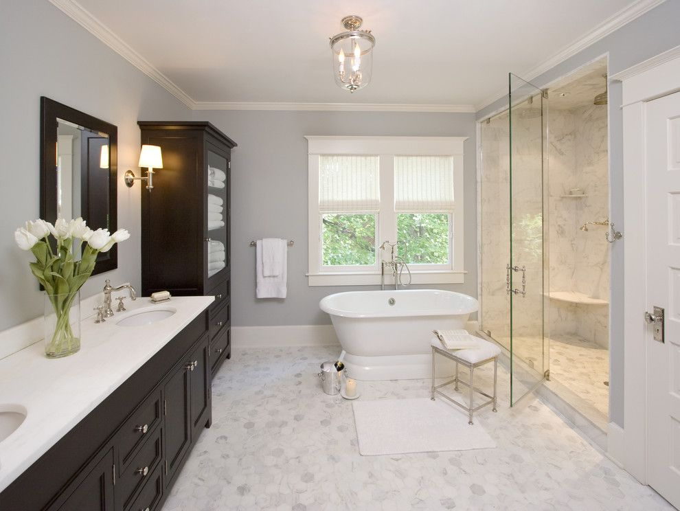 Vaughan Lighting for a Traditional Bathroom with a Towel Storage and Clawson Architects Projects by Clawson Architects, Llc