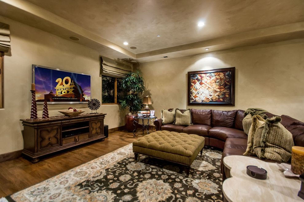 Venetian Plaster for a Mediterranean Home Theater with a Game Room and Mediterranean Media Room by Stotlerdesigngroup.com