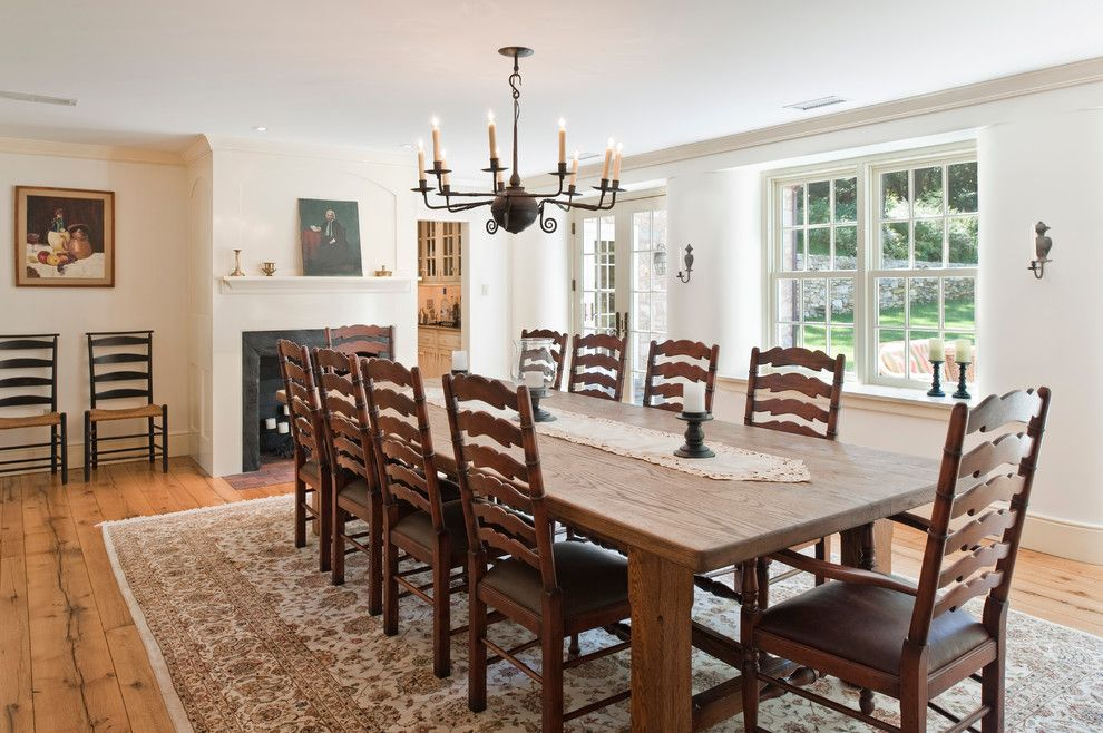 Vermont Farm Table for a Farmhouse Dining Room with a Wood Chairs and Cold Springs Farm by Period Architecture Ltd.