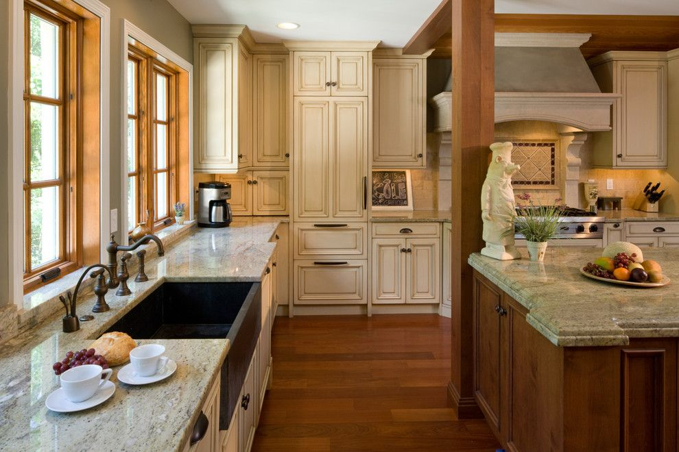 Vermont Soapstone for a Mediterranean Kitchen with a Granite Counter and Ruxton Kitchen by Hbf Plus Design