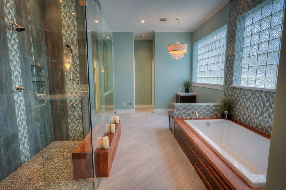 Vertical Bathtub for a Contemporary Bathroom with a Mosaic Tile Shower Floor and Lake House by Glendarroch Homes