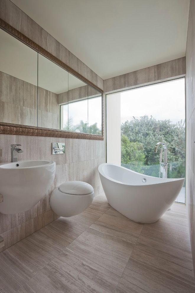 Vertical Bathtub for a Contemporary Bathroom with a Wall Mount Sink and Contemporary Washroom by Bespoke on Khyber