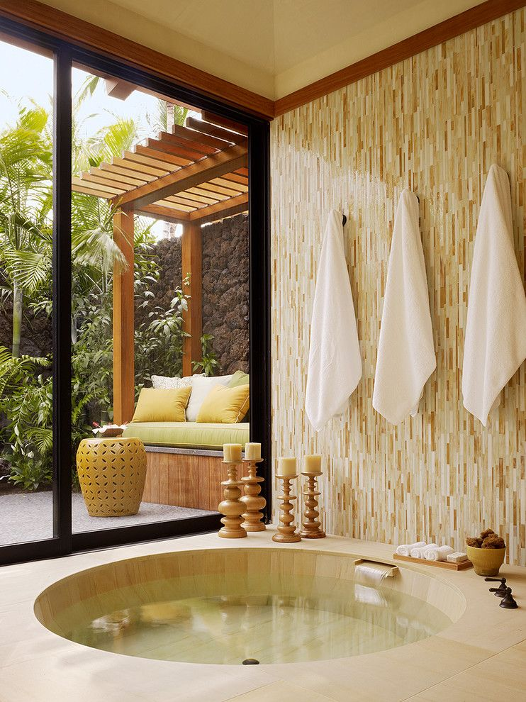 Vertical Bathtub for a Tropical Bathroom with a Patio and Kanae Lot 1 by Gm Construction, Inc.