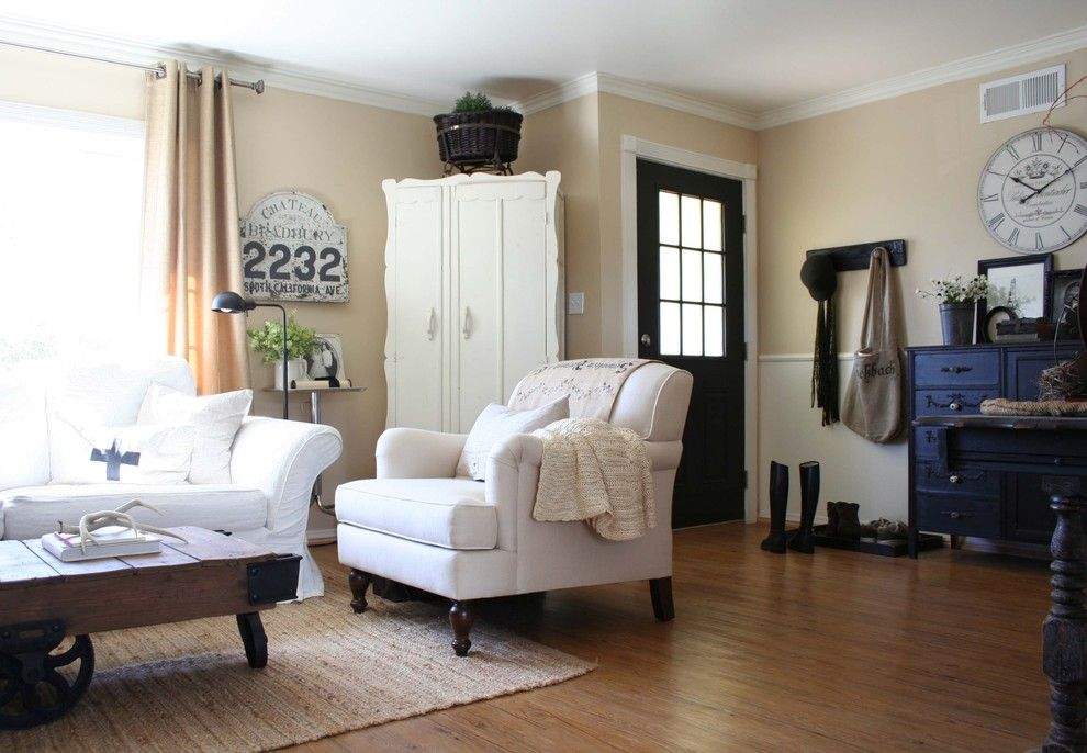 Vinyl vs Laminate for a Traditional Living Room with a Old Sign and Sunny and Bright Living Room by Jennifer Grey Interiors