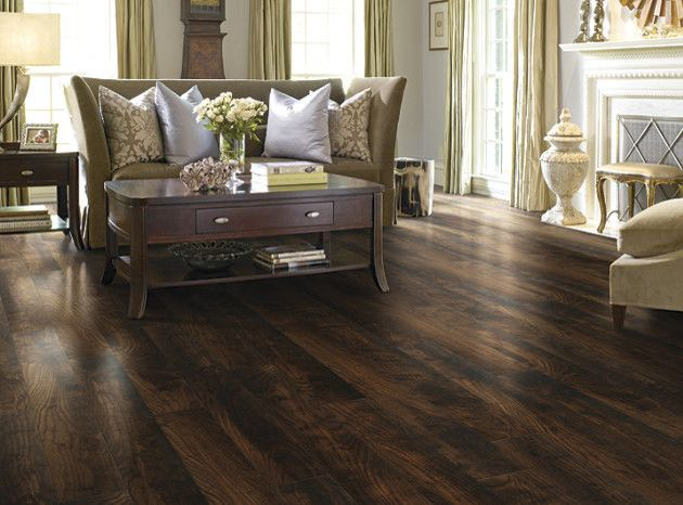Vinyl vs Laminate for a Transitional Living Room with a Floor to Ceiling Drapery and Laminate Flooring by Nest Expressions