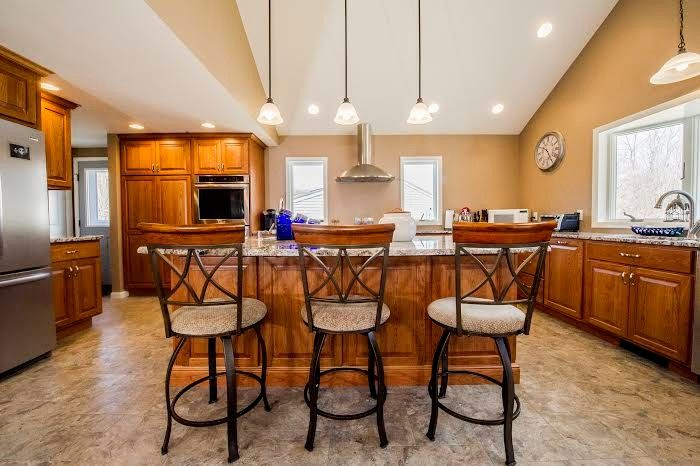Virginia Mist Granite for a Traditional Kitchen with a Pendant Lighting and Kitchen Remodeling by Razzano Homes and Remodelers, Inc.