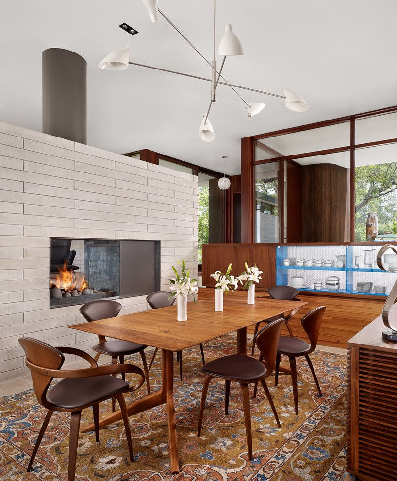 Vortex Doors for a Midcentury Dining Room with a Wood Dining Table and Lake View Residence by Alterstudio