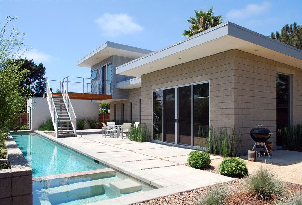 Vortex Doors for a Midcentury Exterior with a Modern Back Yard and North Rios Residence by Jlc Architecture