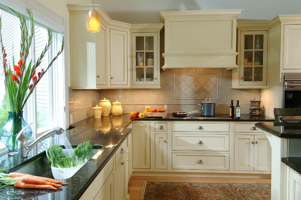 Vortex Doors for a Traditional Kitchen with a Beige Backsplash and Thomas Buckborough & Associates by Thomas Buckborough & Associates