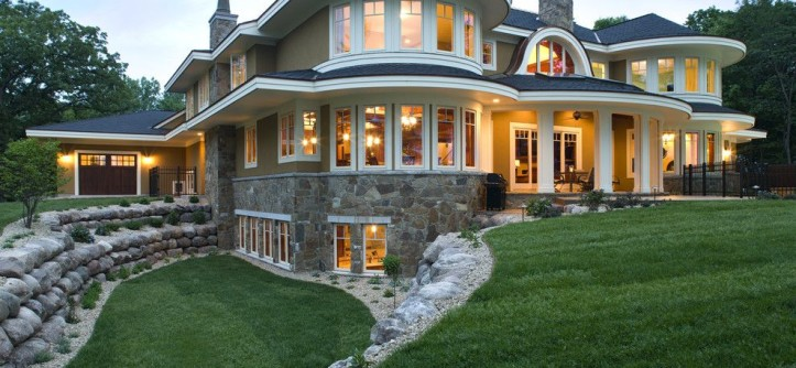 Walkout Basement for a Beach Style Exterior with a Beach Style and Lakeside Exterior by John Kraemer & Sons
